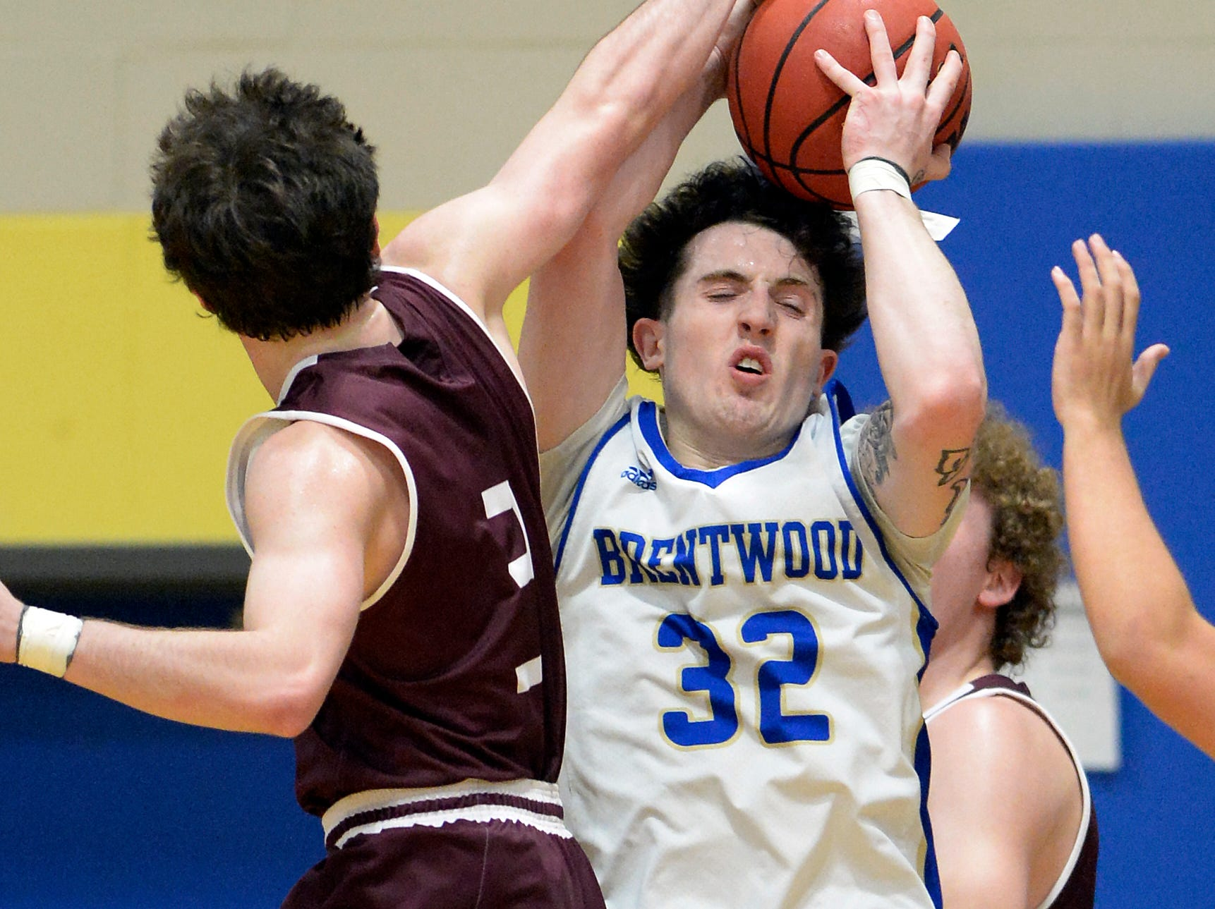 Brentwood guard Jack Thurman (32) pulls down a rebound as he is defended by Franklin guard Reese Glover (3) during the first half of an High School basketball game Tuesday, Jan. 15, 2019, in Brentwood, Tenn.