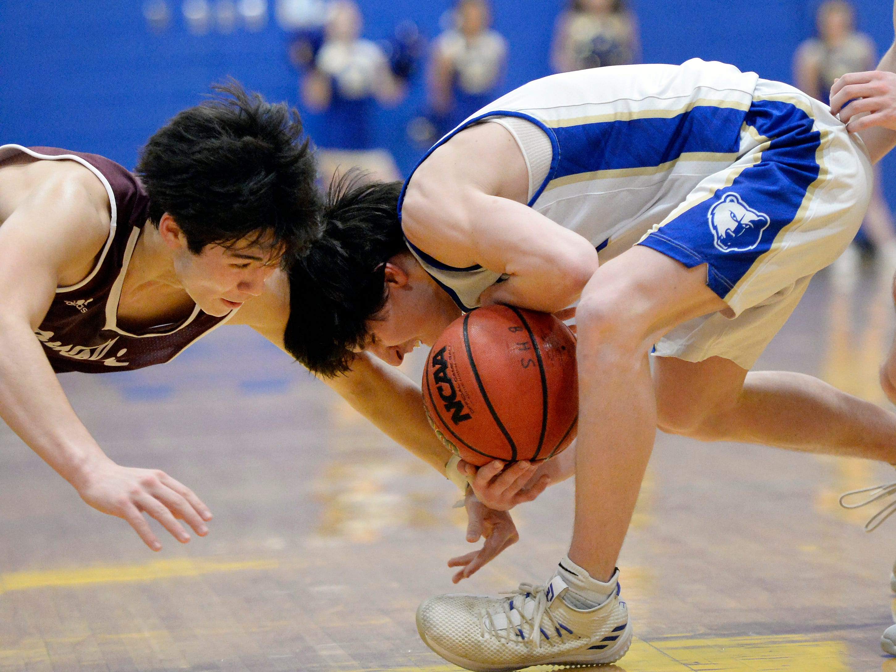 Franklin guard Reed Kemp, left, battles Brentwood guard Preston Moore (12) for the ball during the second half of an High School basketball game Tuesday, Jan. 15, 2019, in Brentwood, Tenn. Franklin won 53-51.
