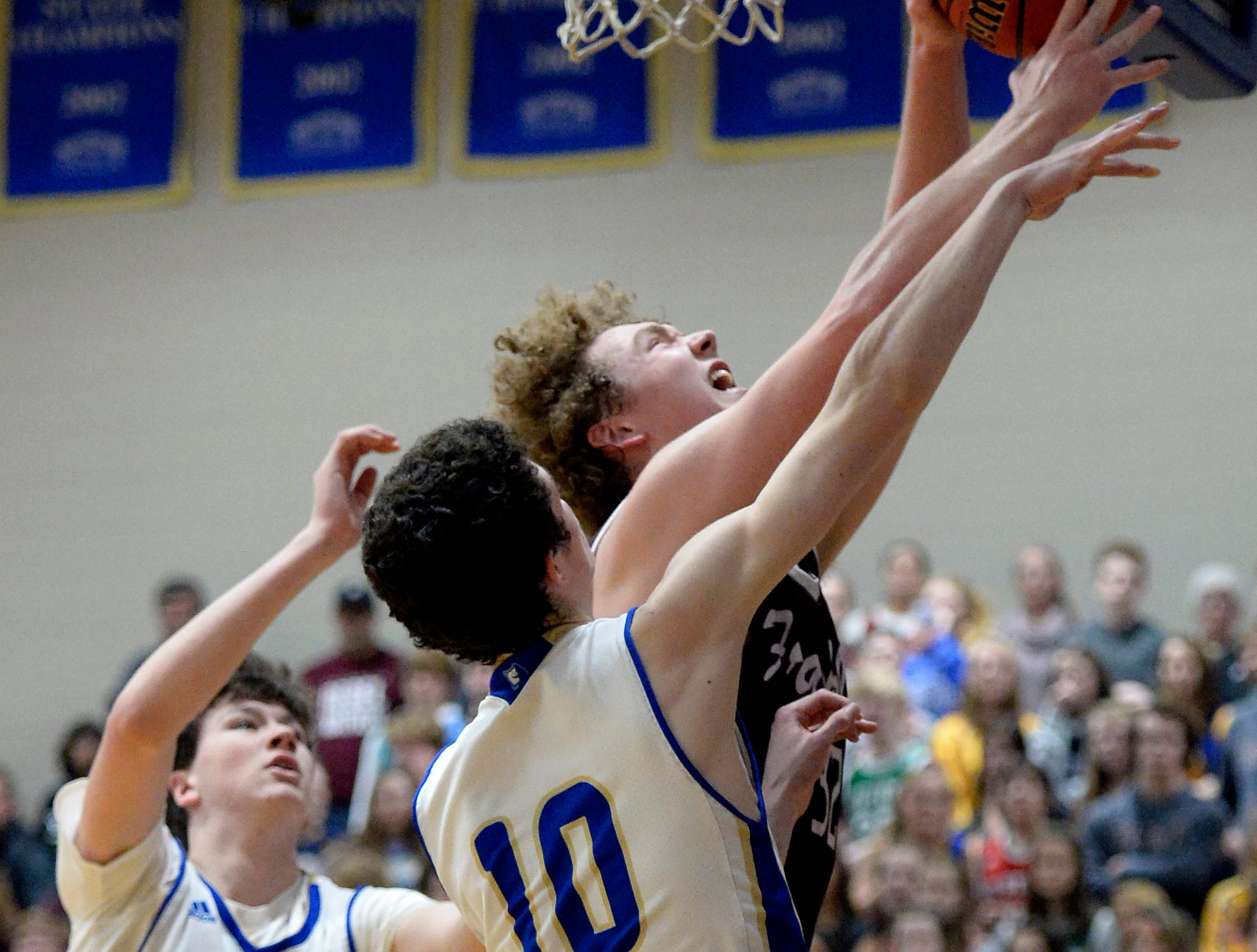 Franklin forward Matt Thurman, right, and Brentwood guard John Windley (10) reach for a rebound during the second half of an High School basketball game Tuesday, Jan. 15, 2019, in Brentwood, Tenn. Franklin won 53-51.