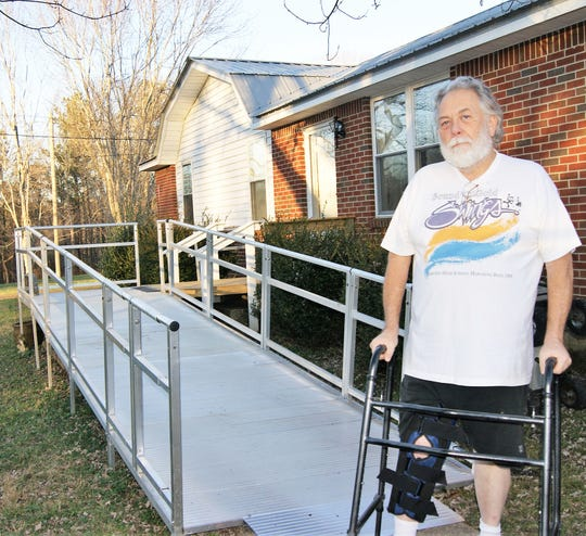 Fairview veteran Don Holt stands beside the temporary, aluminum ramp provided to him by American Legion Post 248.