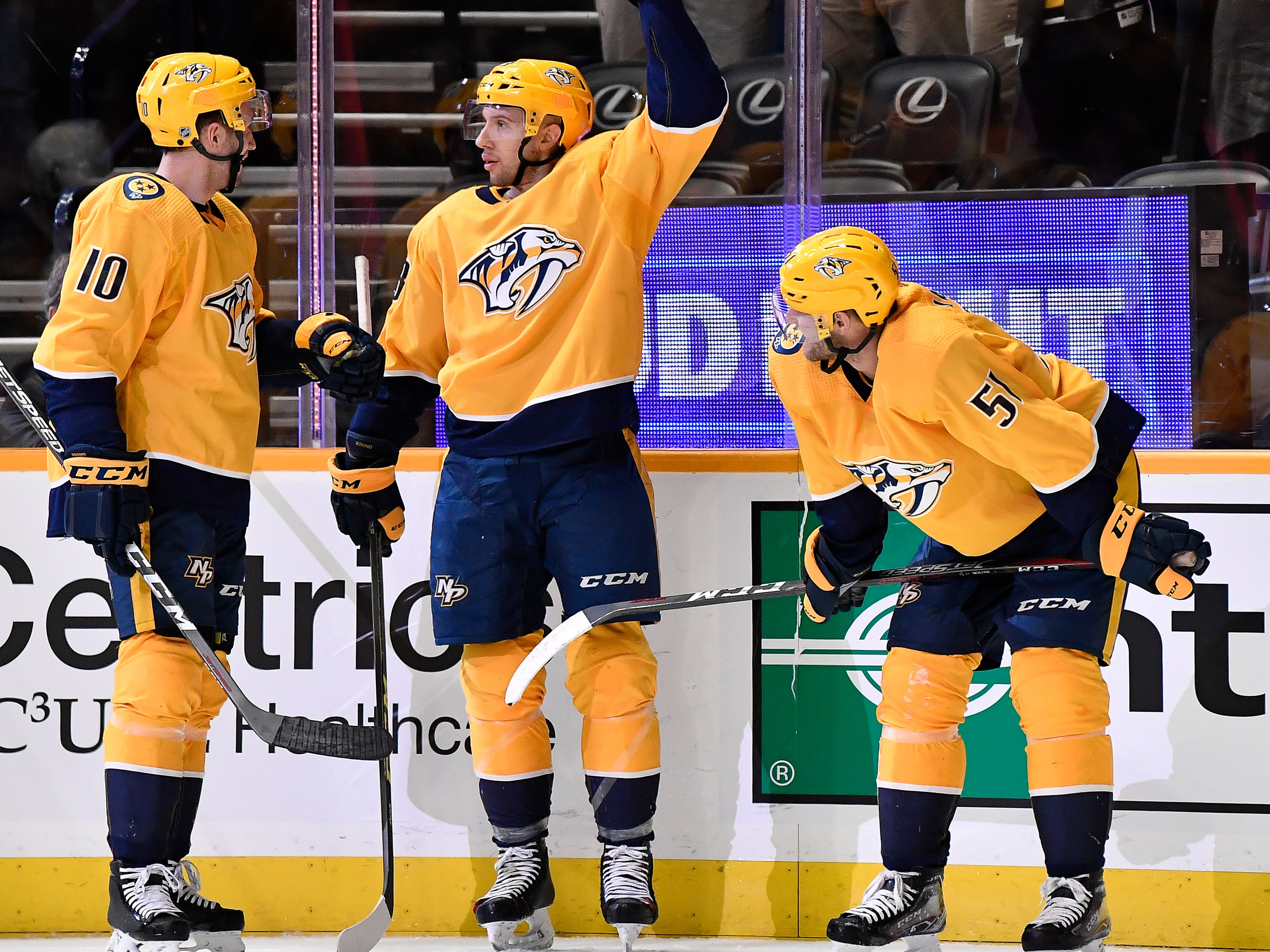 Predators center Nick Bonino (13) celebrates his goal against the Capitals with teammates center Colton Sissons (10) and left wing Austin Watson (51) during the first period at Bridgestone Arena Tuesday, Jan. 15, 2019, in Nashville, Tenn.