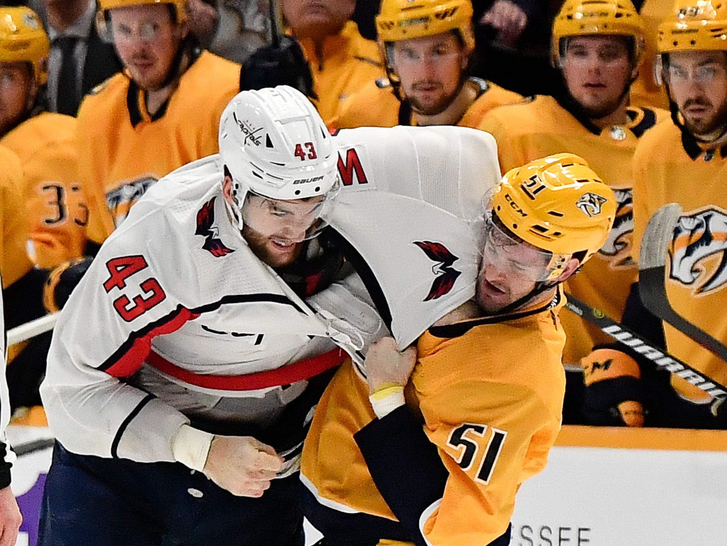 Predators left wing Austin Watson (51) fights with Capitals right wing Tom Wilson (43) during the second period at Bridgestone Arena Tuesday, Jan. 15, 2019, in Nashville, Tenn.