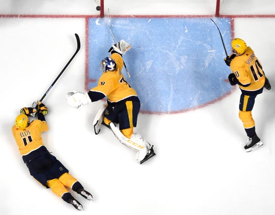 Predators defenseman Ryan Ellis (4), goaltender Juuse Saros (74) and center Colton Sissons (10) defend the goal  against the Capitals during the third period at Bridgestone Arena Tuesday, Jan. 15, 2019, in Nashville, Tenn.