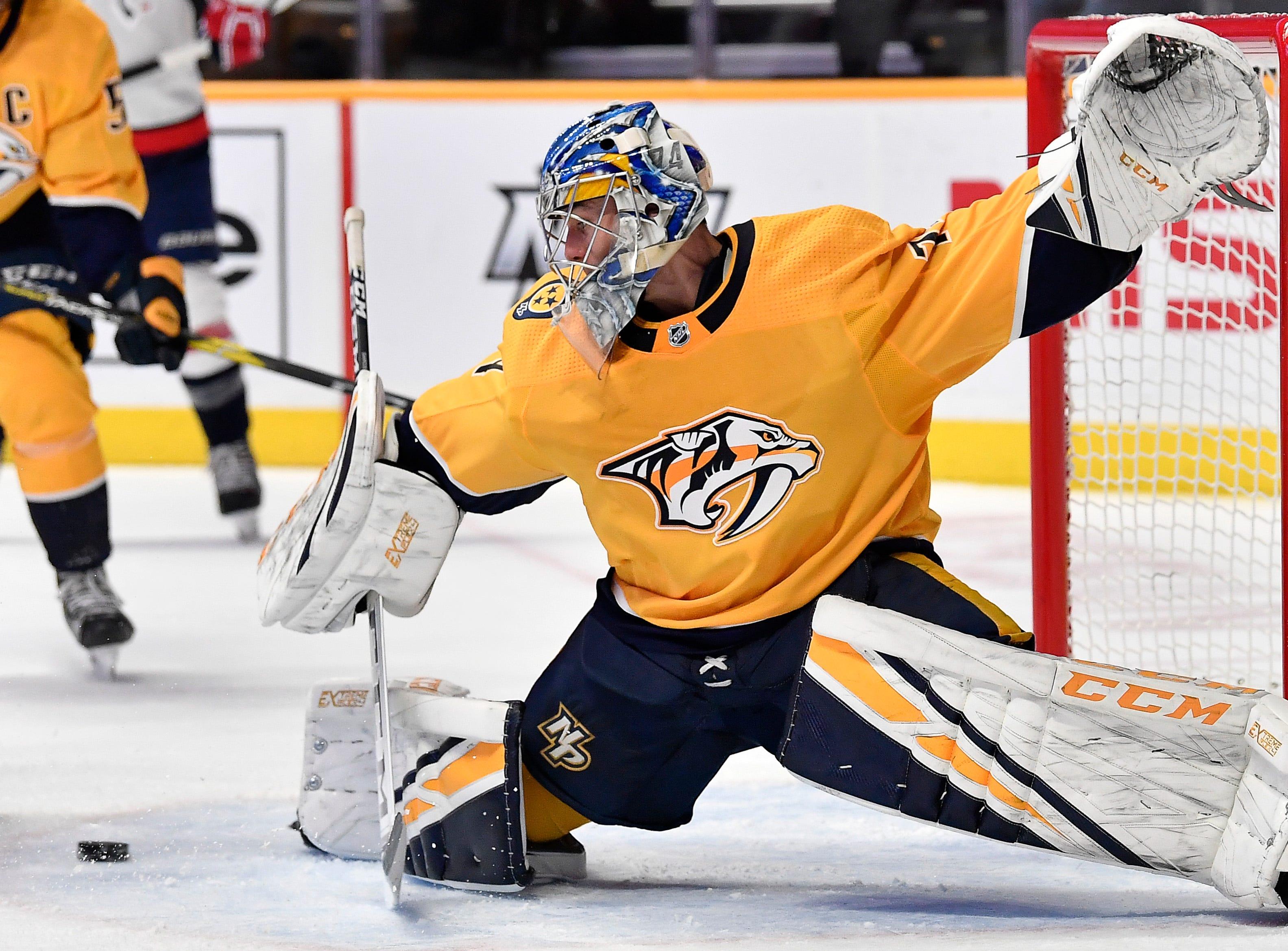 Predators goaltender Juuse Saros (74) blocks a Capitals shot on goal during the second period at Bridgestone Arena Tuesday, Jan. 15, 2019, in Nashville, Tenn.