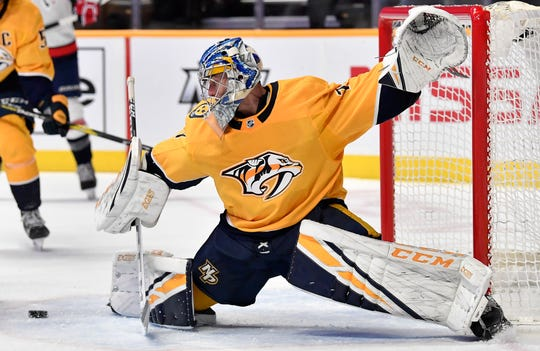 Predators goaltender Juuse Saros (74) blocks a Capitals shot on goal during the second period Tuesday.