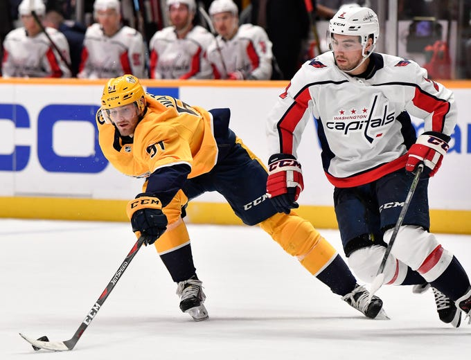 Predators left wing Austin Watson (51) takes the puck, from Capitals defenseman Matt Niskanen (2) during the third period at Bridgestone Arena Tuesday, Jan. 15, 2019, in Nashville, Tenn.
