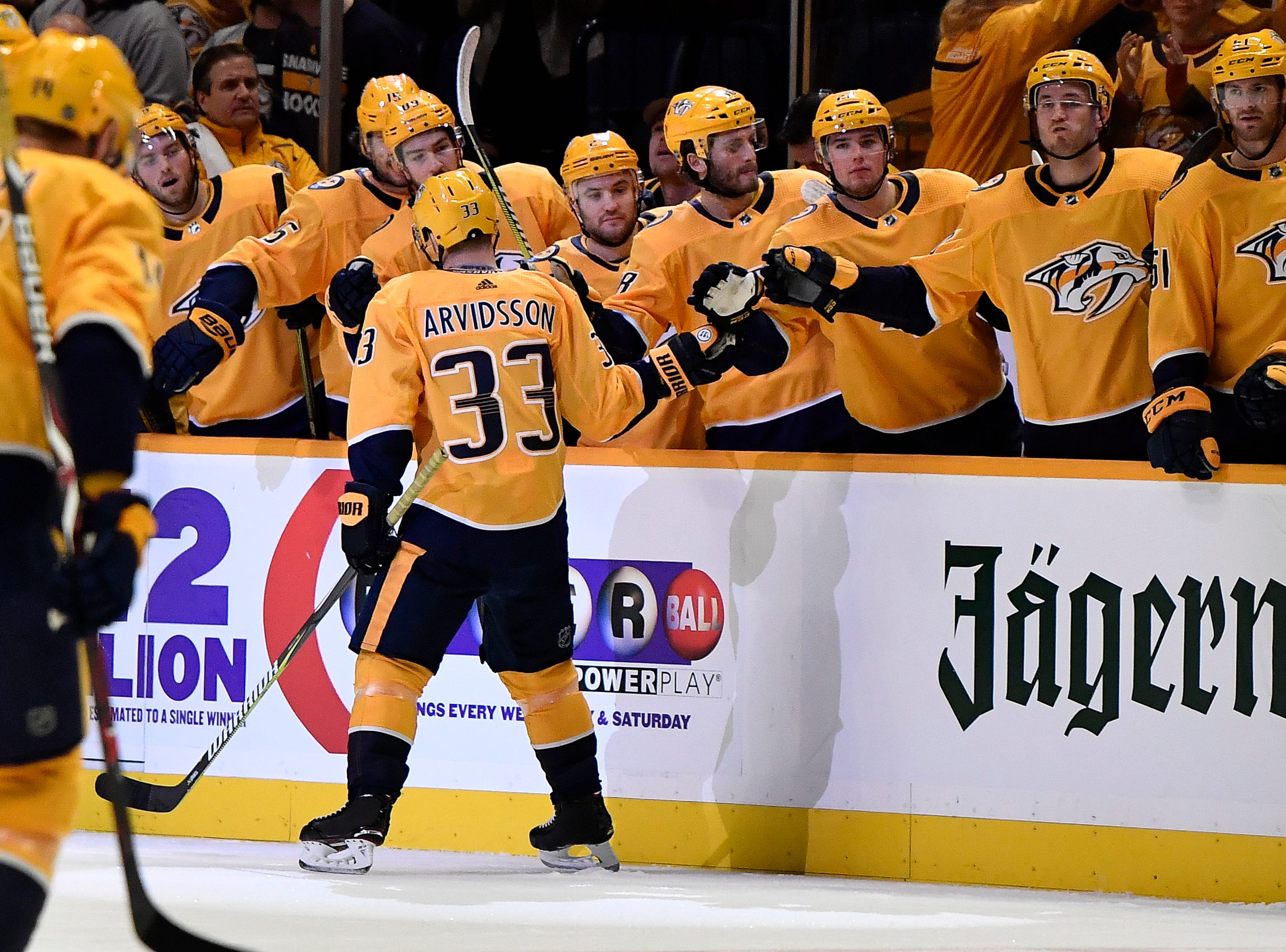 Predators right wing Viktor Arvidsson (33) is congratulated after his goal during the first period against the Capitals at Bridgestone Arena Tuesday, Jan. 15, 2019, in Nashville, Tenn.