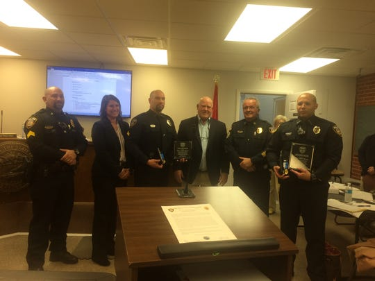 Ashland City officials recognize Officer Garry Brown and Corporal Andrew Spencer for stopping an apparent suicide attempt and protecting area citizens in October 2018.