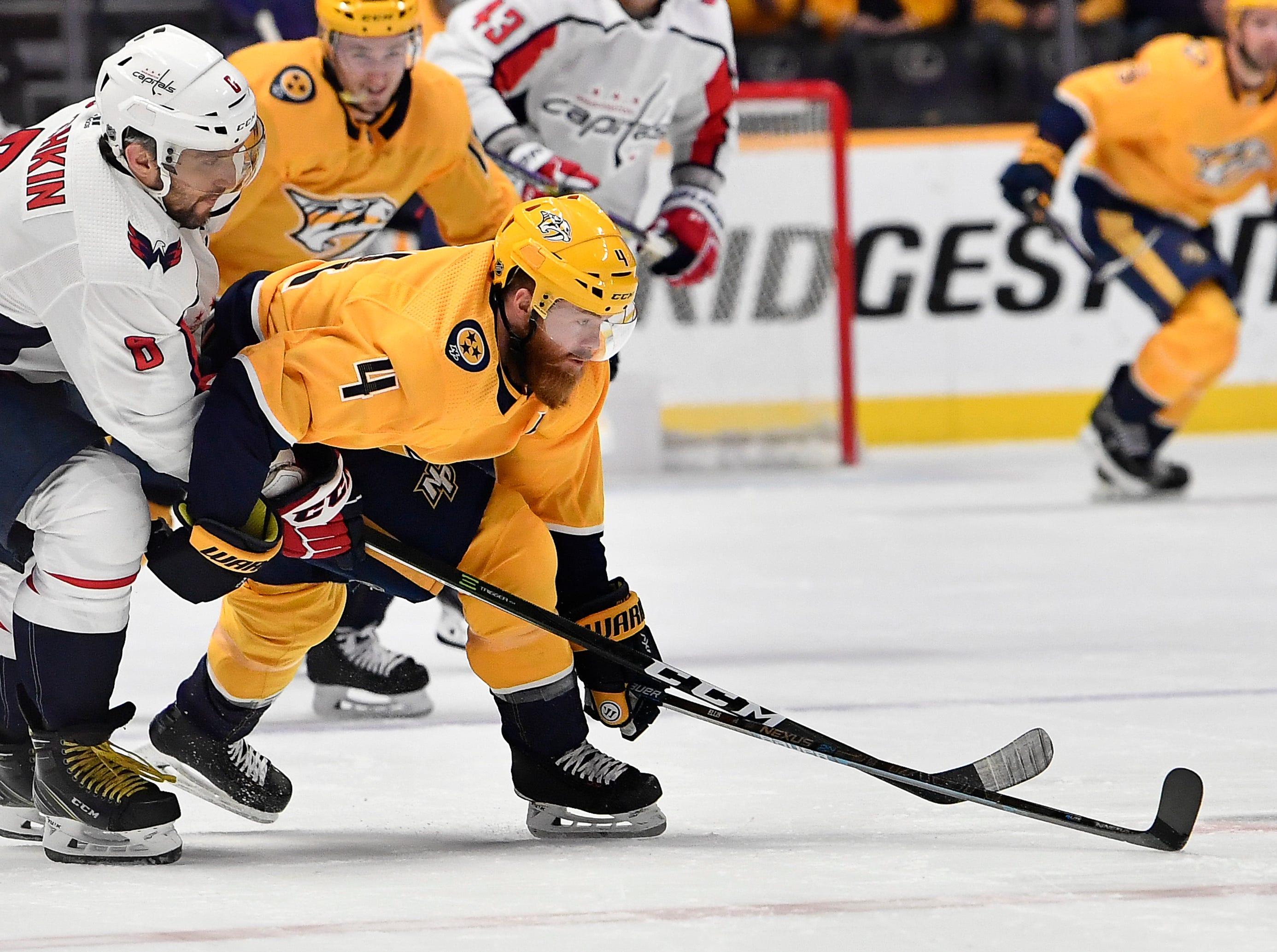 Predators defenseman Ryan Ellis (4) takes the puck from Capitals left wing Alex Ovechkin (8) during the first period at Bridgestone Arena Tuesday, Jan. 15, 2019, in Nashville, Tenn.