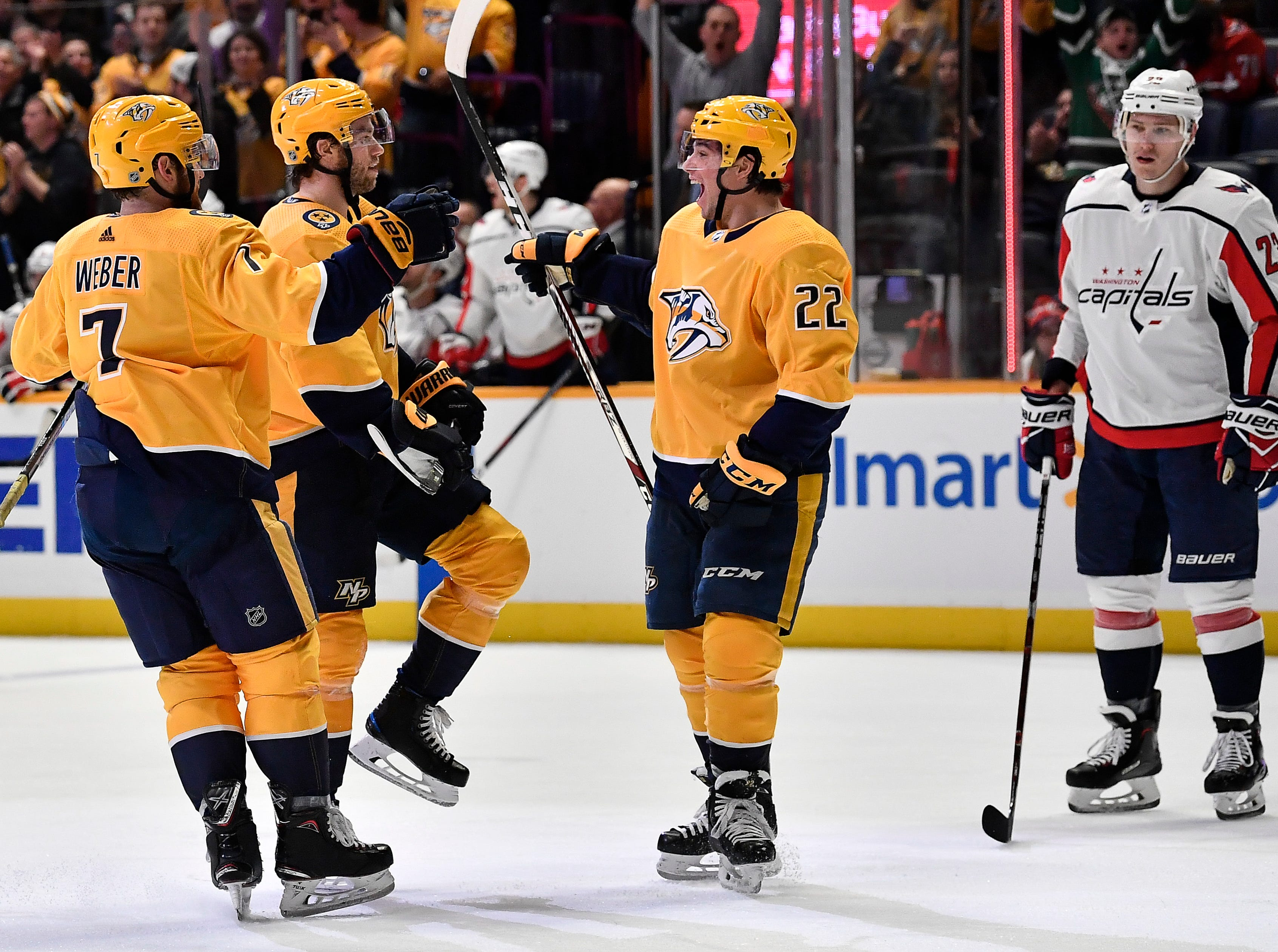 Predators center Calle Jarnkrok (19) celebrates his goal against the Capitals with defenseman Yannick Weber (7) and left wing Kevin Fiala (22) during the third period at Bridgestone Arena Tuesday, Jan. 15, 2019, in Nashville, Tenn.