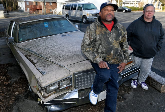 When temperatures dip and they have no other place to go, homeless couple William McLemore and Amy Webb sometimes sleep in this abandoned car near a Franklin church.
