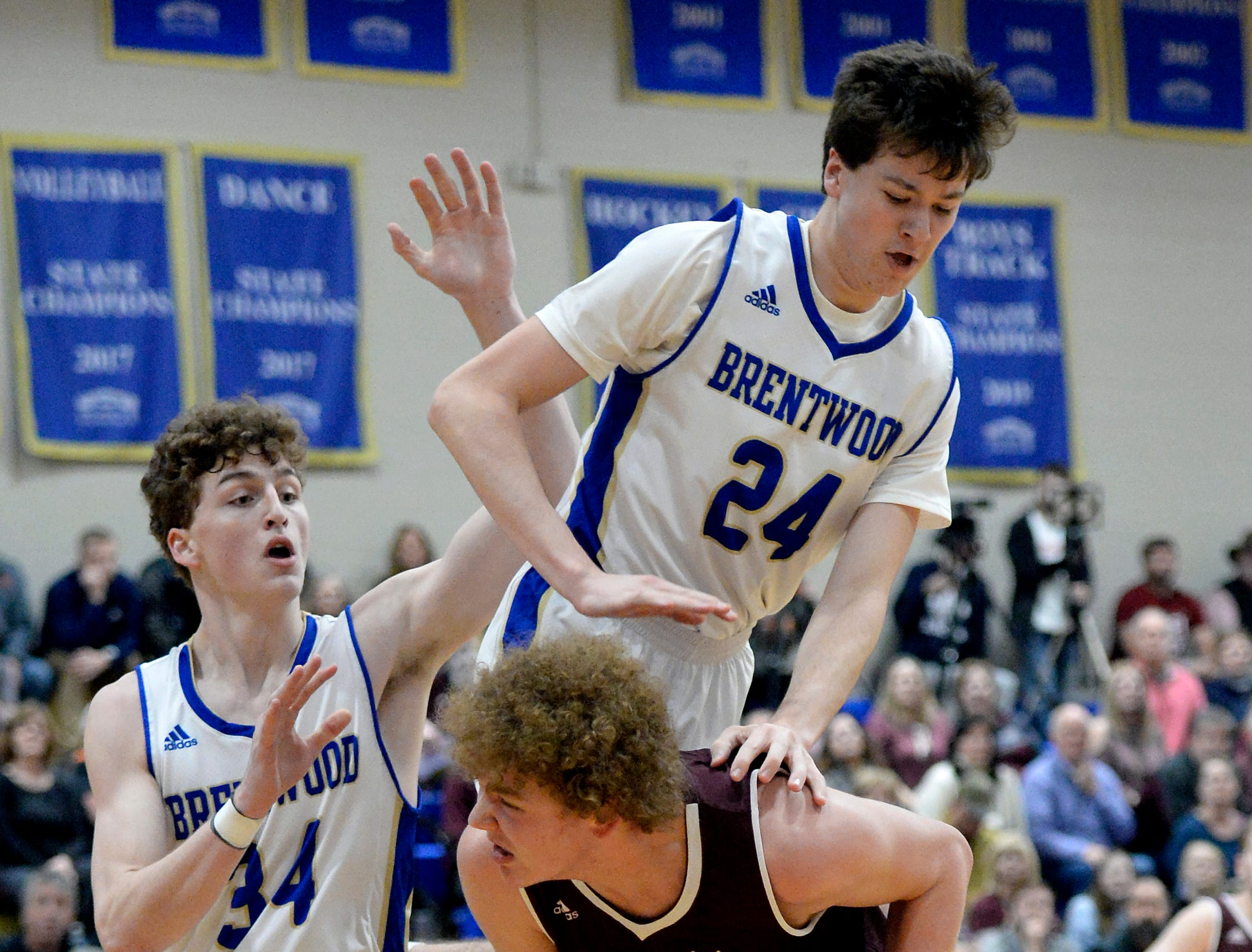 Brentwood forward Cole Massey (24) falls on Franklin forward Matt Thurman (32) fouling Thurman during the first half of an High School basketball game Tuesday, Jan. 15, 2019, in Brentwood, Tenn.