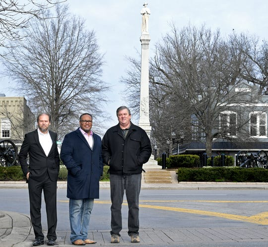 Local historian and Battle of Franklin Trust CEO Eric Jacobson, left, stands with Franklin pastors Chris Williamson and Kevin Riggs near Franklin's own Confederate monument in the public square.  The group wants to add markers that will share Franklin's history involving slavery, the riot of 1867 and Jim Crow. There will also be a statue of a U.S. Colored Troop in front of the old courthouse.