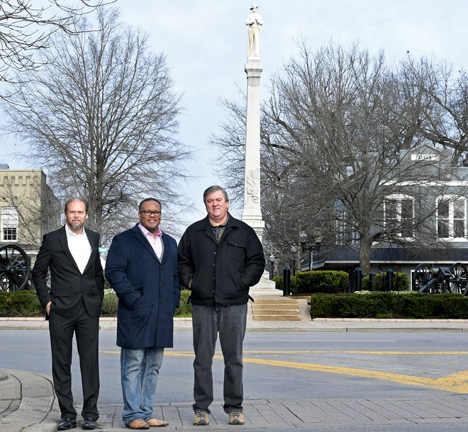 Local historian and Battle of Franklin Trust CEOEric Jacobson, left, stands with Franklin pastors Chris Williamson and Kevin Riggs near Franklin's own Confederate monument in the public square.  The group wants to add markers that will share Franklin's history involving slavery, the riot of 1867 and Jim Crow. There will also be a statue of a U.S. Colored Troop in front of the old courthouse.