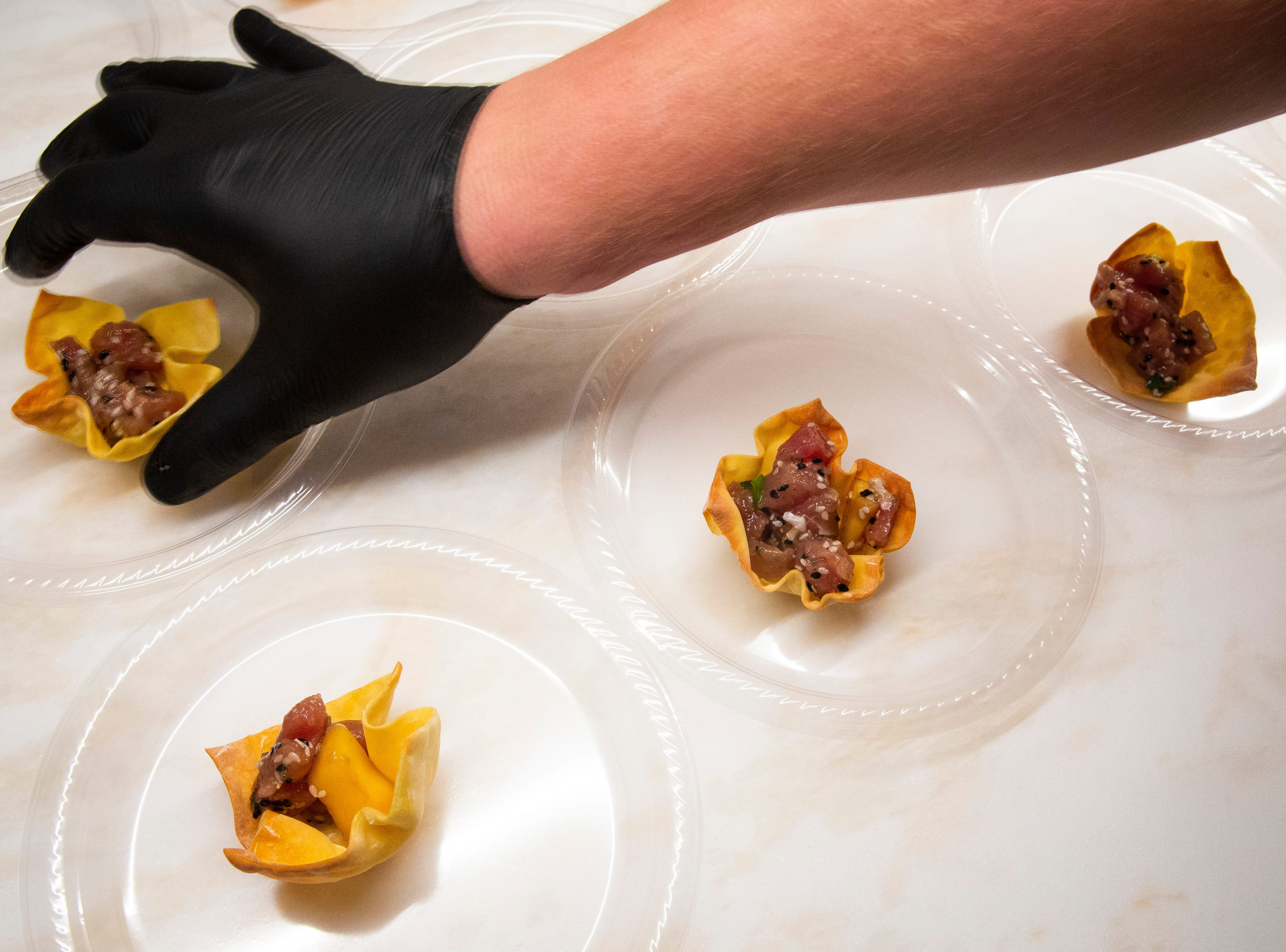 Chef Chris Renninghoff prepares a tuna poke dish during the 7th annual Kitchen Tour, hosted by the Naples Woman's Club in Naples on Wednesday, January 16, 2019.