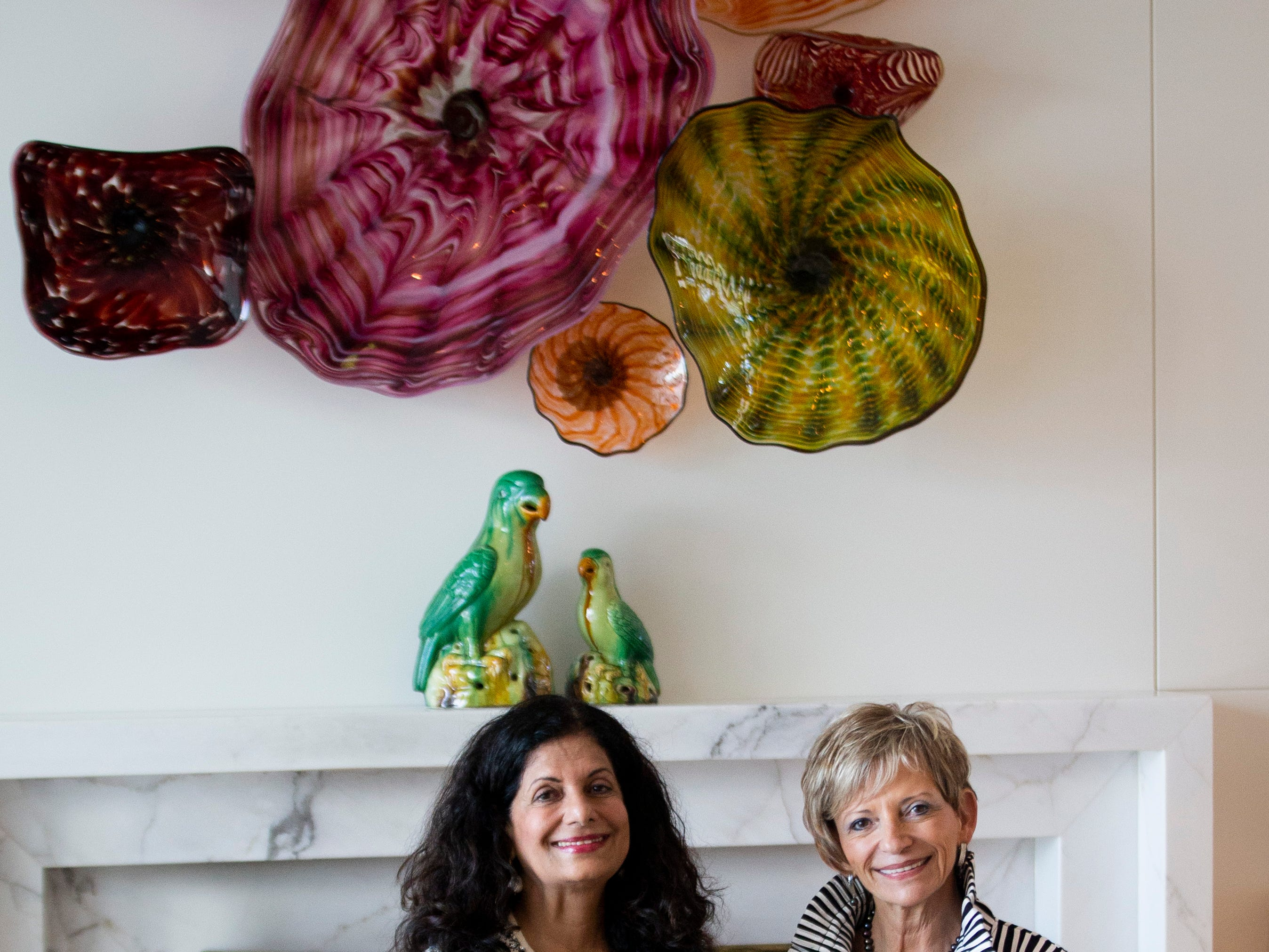 Homeowner Zoreen Ansari, left, poses for a portrait in her living room with Lee Kraus, chair of the Kitchen Tour and past president of the Naples Woman's Club, during the 7th annual Kitchen Tour, hosted by the Naples Woman's Club in Naples on Wednesday, January 16, 2019.