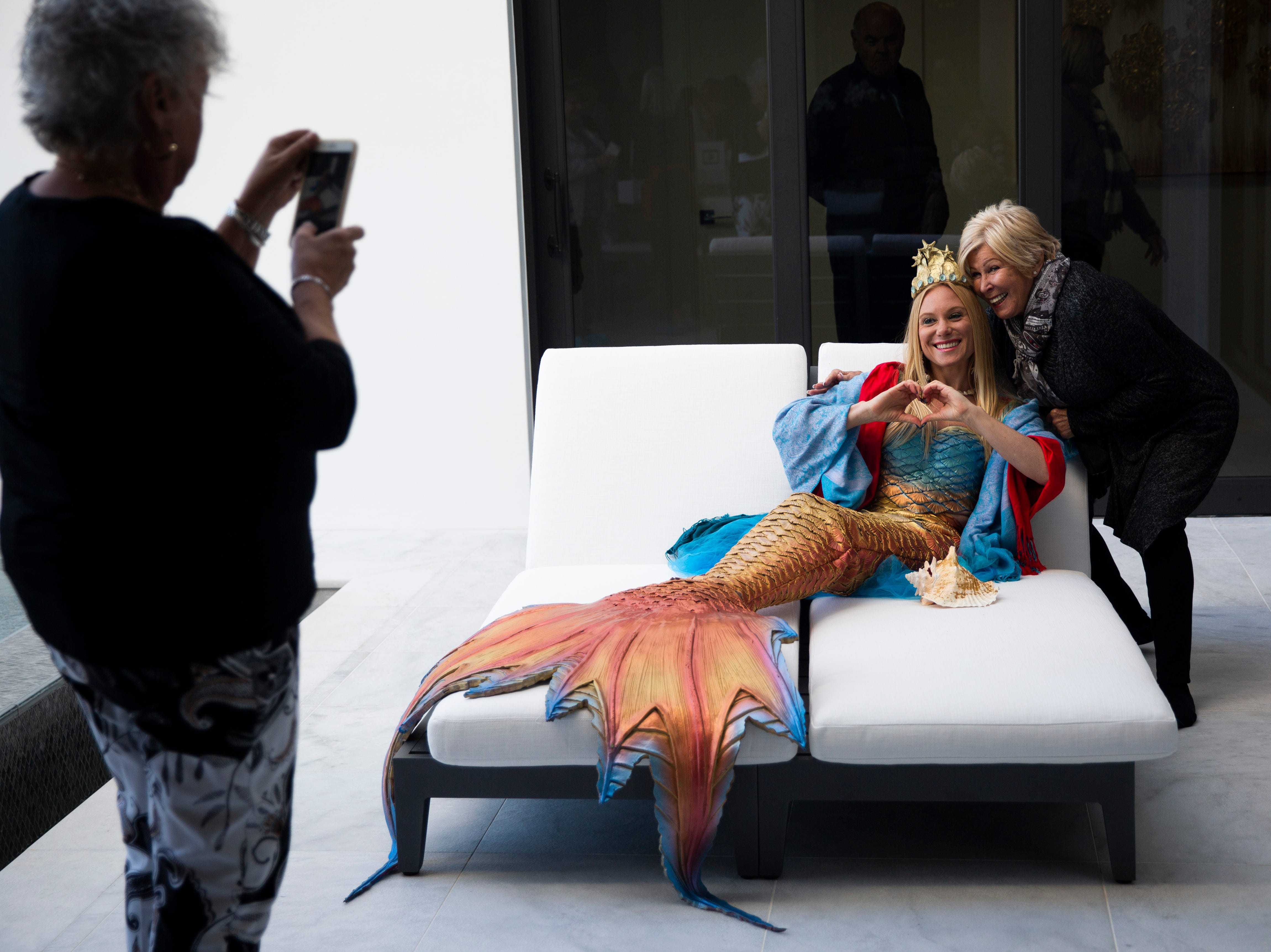 Joanie Zuckerman takes a photo of Pam Schultz as she poses with Shelley McKernan, also known as Sea Shelley, during the 7th annual Kitchen Tour, hosted by the Naples Woman's Club in Naples on Wednesday, January 16, 2019.