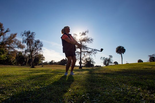 Wendy Jervis, a Par One resident, chips balls onto the practice green, Wednesday, Jan. 16, 2019, at the golf course at the Golden Gate Country Club near the intersection of Collier Boulevard and Golden Gate Parkway.