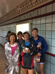 Jeannie Rice, 70, (left) poses with fellow Gulf Coast Runners members after breaking the women's 70-and-older world record time at the Chicago Marathon in October 2018. From left to right: Rice, Sandy Waite, Mary Iamurri, Dawna Hollowell.
