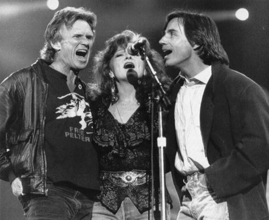 IndyStar file Kris Kristofferson, Bonnie Raitt and Jackson Browne (from left) perform during Farm Aid IV. Kris Kristofferson, Bonnie Raitt and Jackson Browne (from left) perform during Farm Aid IV in Indianapolis April 7, 1990.