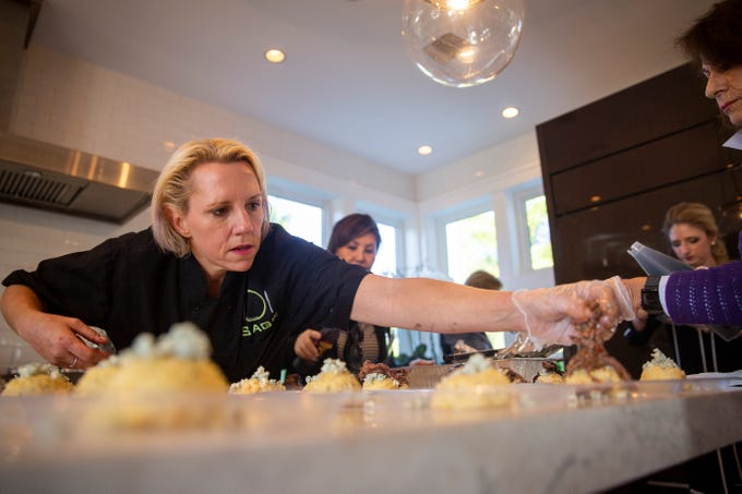 Sage Catering Chef Amber Phillips prepares her dish before the arrival of the next bus during the 7th annual Kitchen Tour, hosted by the Naples Woman's Club in Naples on Wednesday, January 16, 2019. Proceeds from the Kitchen Tour go to multiple charities, including the Guadalupe Early Education Center in Immokalee, the Judy Sullivan Family Resource Center, Youth Haven, and Naples Woman's Club scholarships.