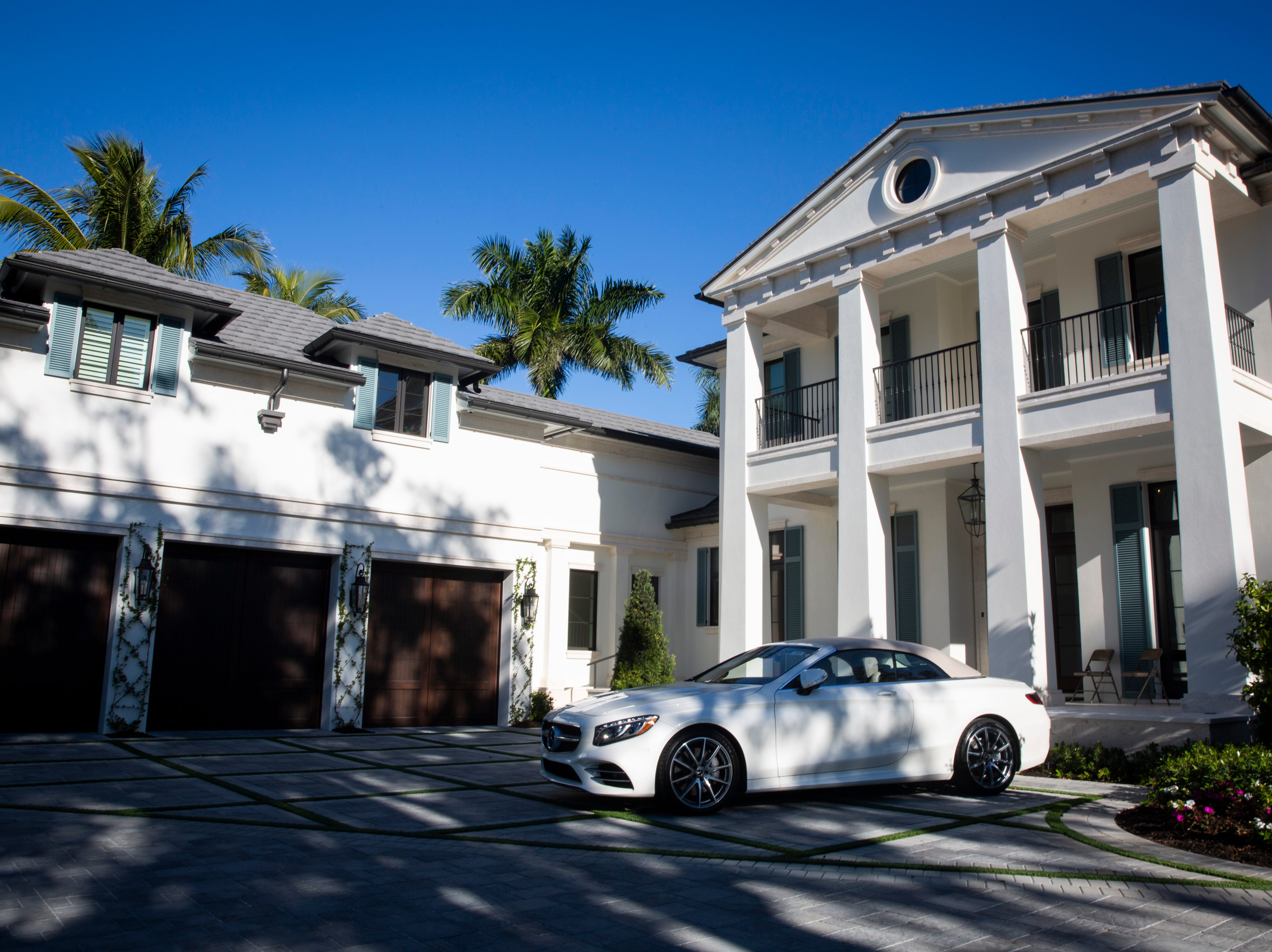 A new Mercedes-Benz is parked outside of a home on Green Dolphin Drive in Port Royal during the 7th annual Kitchen Tour, hosted by the Naples Woman's Club on Wednesday, January 16, 2019. Luxury cars available for sale were parked outside of three of the homes on the tour.