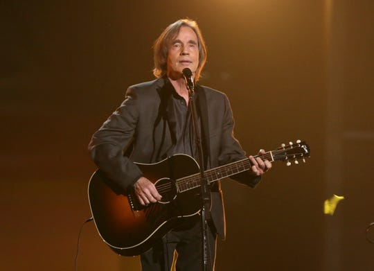 "Browne Jackson Browne performs ""Take It Easy"" during a tribute to Glenn Frey at the 58th annual Grammy Awards on Monday, Feb. 15, 2016, in Los Angeles. (Photo by Matt Sayles/Invision/AP)"