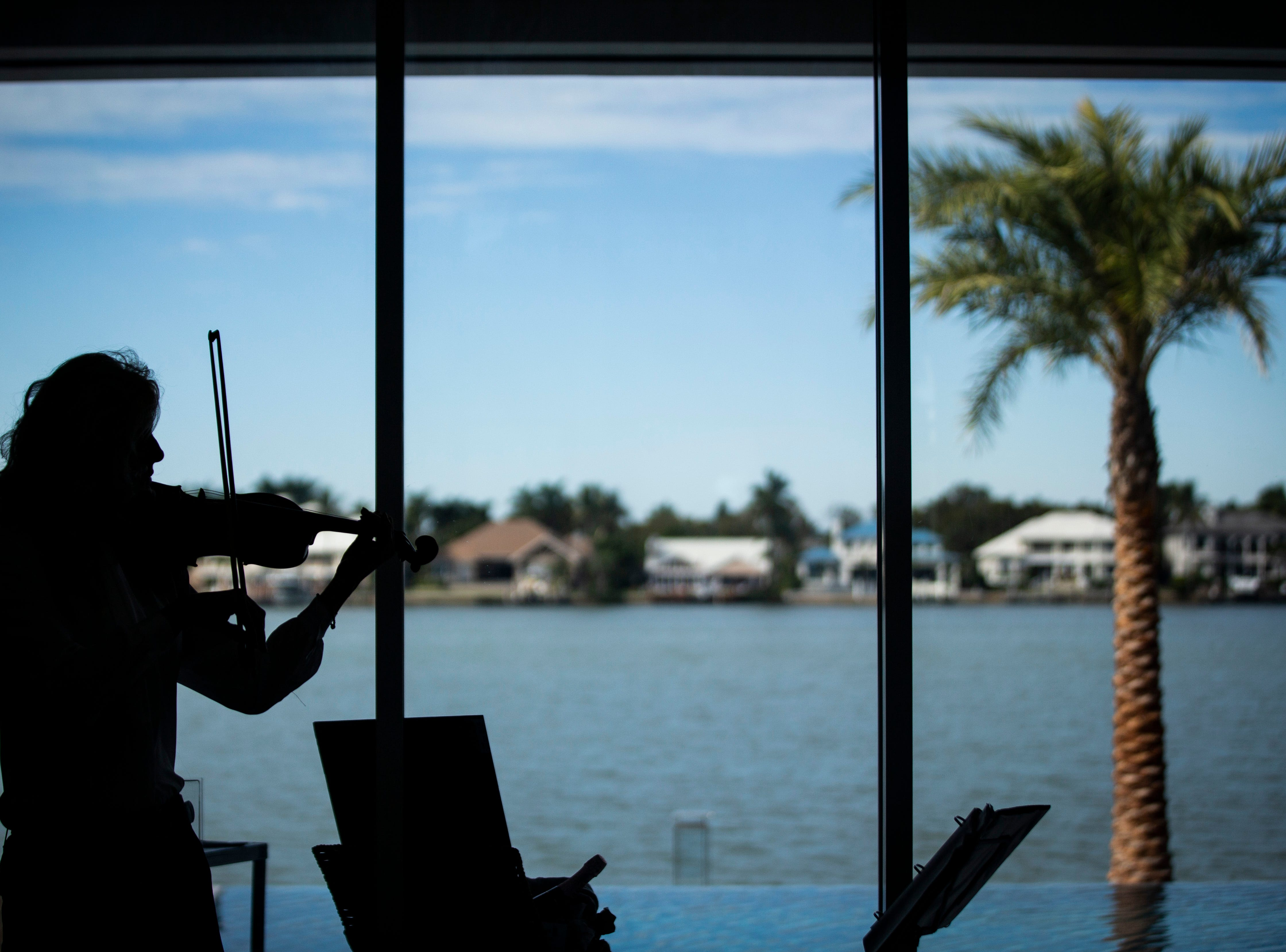 Bianca Cirakovic plays the violin during the 7th annual Kitchen Tour, hosted by the Naples Woman's Club in Naples on Wednesday, January 16, 2019. The tour featured speakers and entertainment at four different homes in the Naples area.