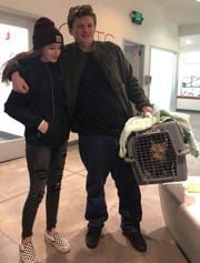 Asa Gorby and his sister, Sara, leave the San Francisco SPCA (Society for the Prevention of Cruelty to Animals) animal shelter last Dec. 20 with their cat, Walker. They drove three hours to retrieve him after a rescue worker found him following the Camp Fire at Paradise.