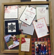 Examples of invitations, holiday cards, and stationary from Just WRITE Fine Paper & Stationery hanging in the East Broadway location in Granville.
