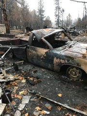 Greg Gorby's burned-out truck is shown near his Paradise, California home that was destroyed by the Camp Fire last November.
