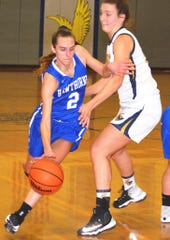 Hawthorne senior guard Heather Bertollo (2) trying to drive by Eastern Christian senior forward Madison Wynbeek.