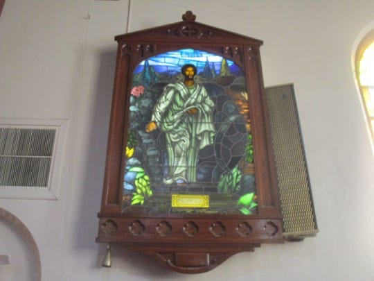 A stained glass window depicting Jesus Christ at Christ Temple Baptist Church in Paterson has been repainted to depict  Christ as an African.
