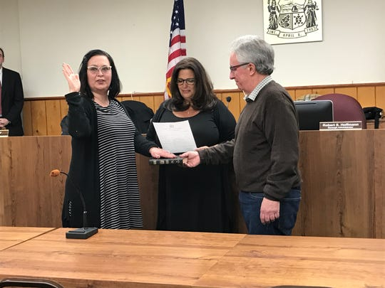 Jill McGuire, left, is sworn into the Emerson Borough Council by Mayor Danielle DiPaola, center. McGuire will serve a one year, unexpired term on the council.