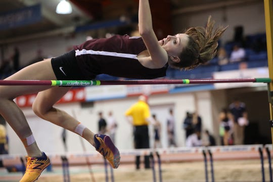Lizzie Veenhof of Ridgewood cleared 5-3, a personal best, in the high jump to help the Maroons girls squad win the Big North Freedom.