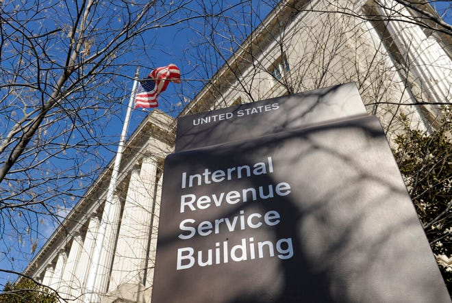 This March 22, 2013 file photo, shows the exterior of the Internal Revenue Service building in Washington. The Internal Revenue Service is recalling about 46,000 of its employees furloughed by the government shutdown, nearly 60 percent of its workforce, to handle tax returns and pay out refunds. The employees won't be paid. (AP Photo/Susan Walsh, File)