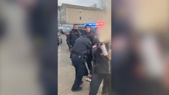 An officer appears to use pepper spray on the person filming the arrest of Jameek Lowery's sister and cousin.