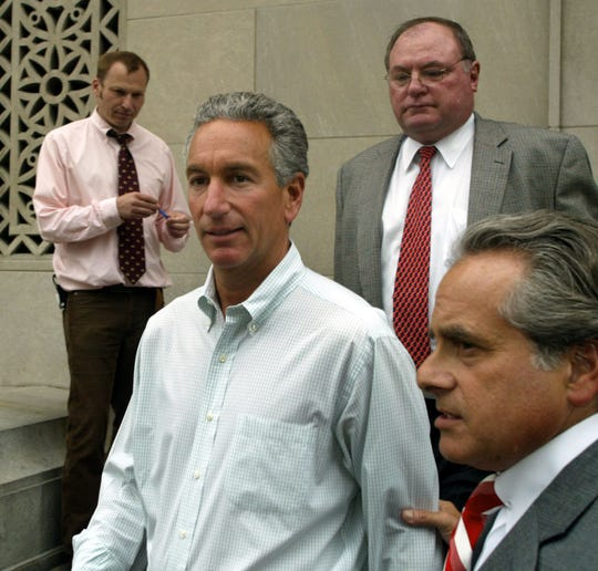 Charles Kushner leaving federal court in Newark in 2004.