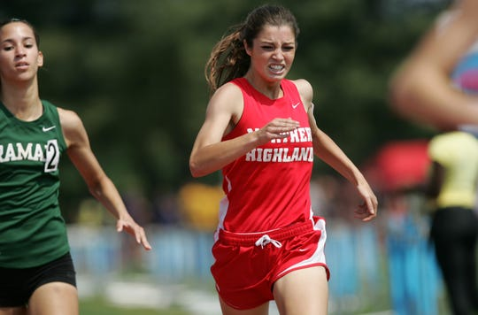 Madison Holleran edgets out Deanna DiLandro during a 2012 race.