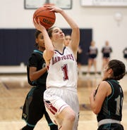 Sophomore Lady 'Cat Sierra Manos (1) spread herself thin on the floor with hustling defense and an 11-point night against the Onate Knights on Tuesday.