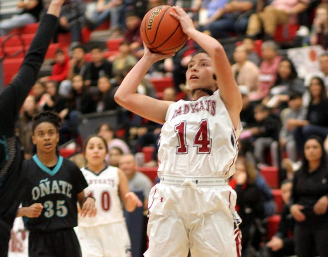 Senior Lady 'Cat Adriana Giron (14) led the Deming girls in scoring with 17 points during Tuesday's 57-51 loss to the Onate High Knights at Deming High School.