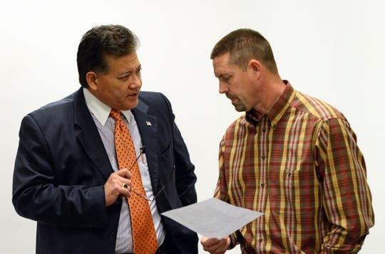 Las Cruces Mayor Ken Miyagishima,  left, speaks to Trent Doolittle, district engineer for the New Mexico Department of Transportation, about options for accelerating the Valley Drive construction project before a public meeting on January 15, 2019.
