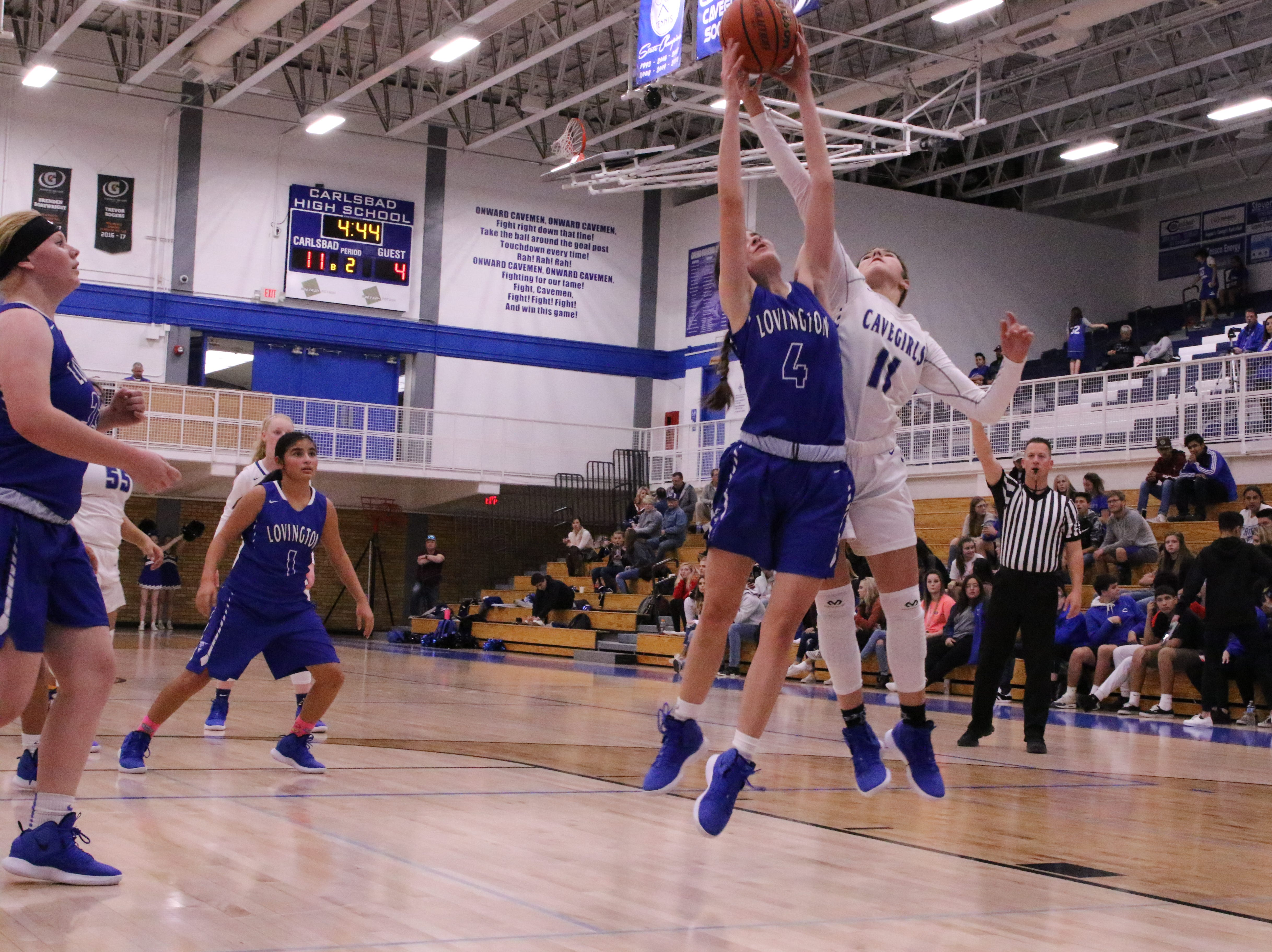 Carlsbad's Teran Tiller (11) gets an offensive rebound in the second quarter against Lovington. Tiller would find Carsyn Boswell for an open 3-pointer to start a 24-2 run in the quarter.