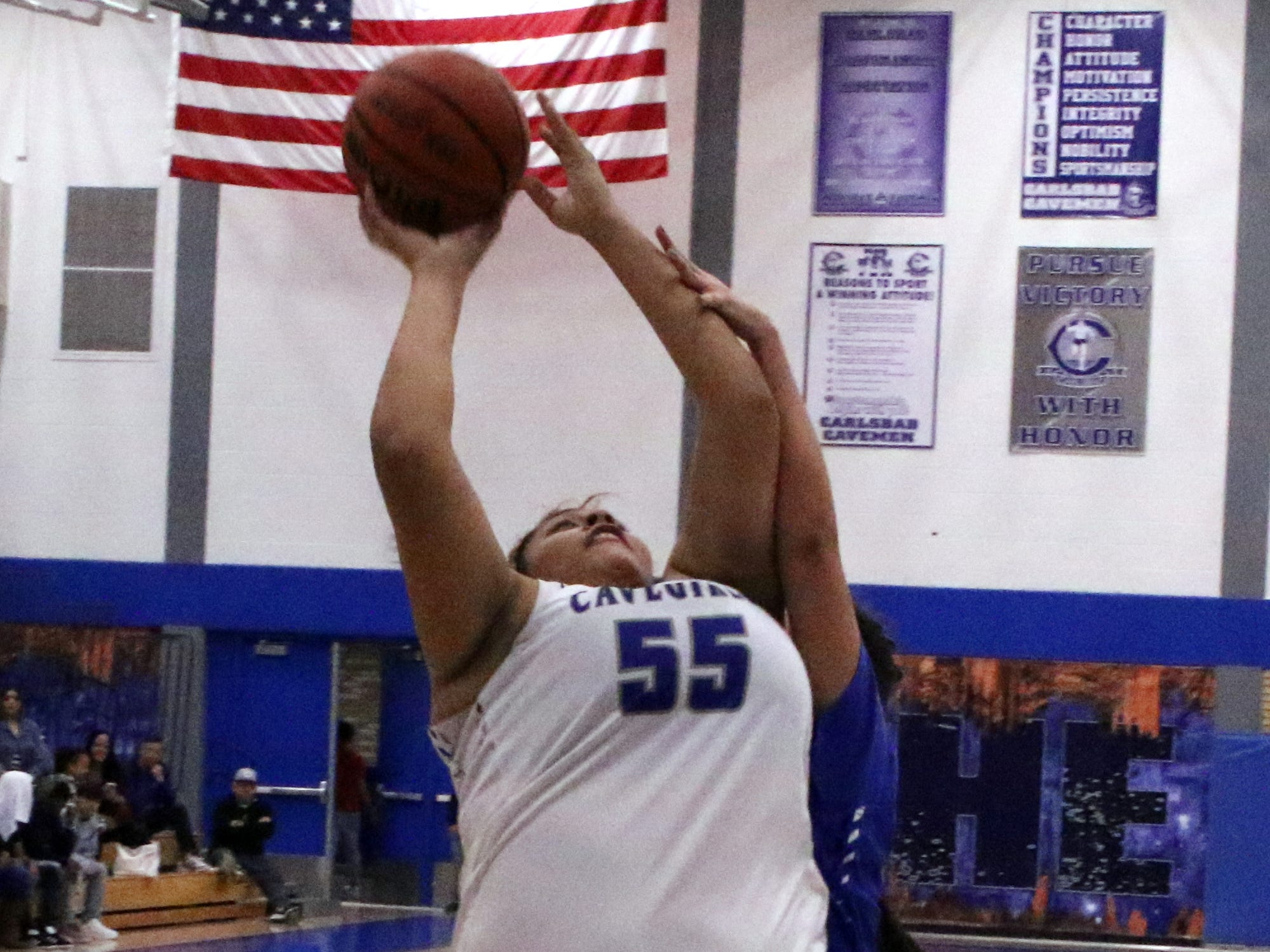 Kaliyah Montoya is fouled going up for a layup in the second half of Tuesday's game against Lovington. She finished with 11 points.