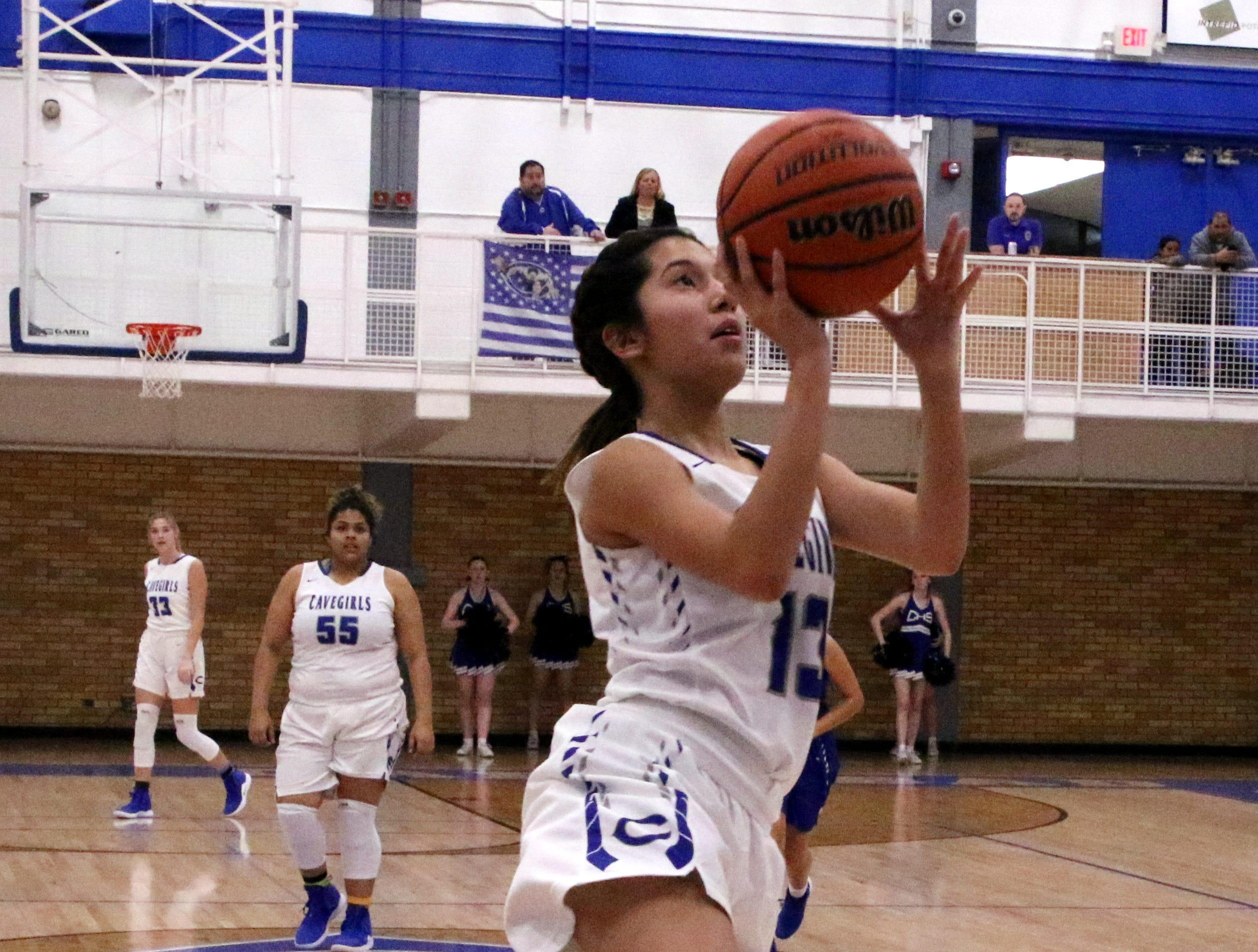 Tori Flores gets a buzzer-beating layup to end the first half against Lovington. She finished with 14 points for the Cavegirls.
