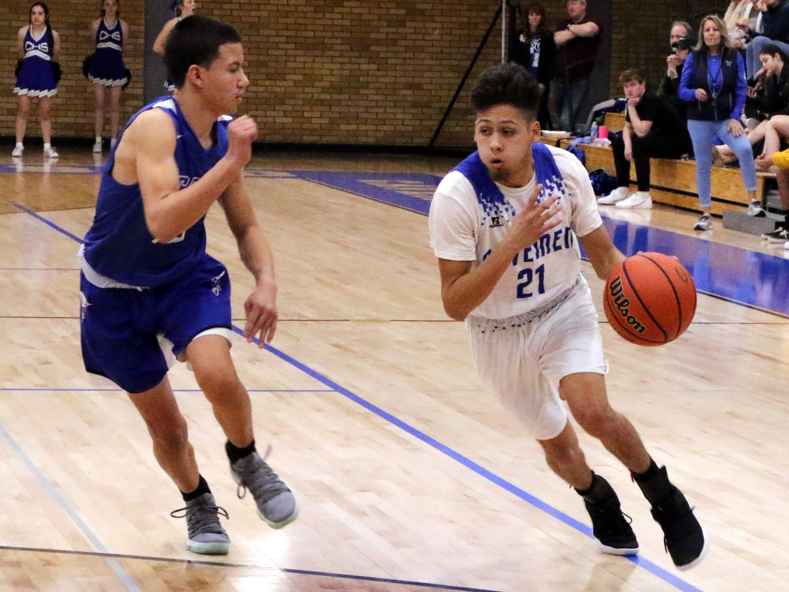 Patrick Espinoza drives the lane in the first quarter during Tuesday's game against Lovington.