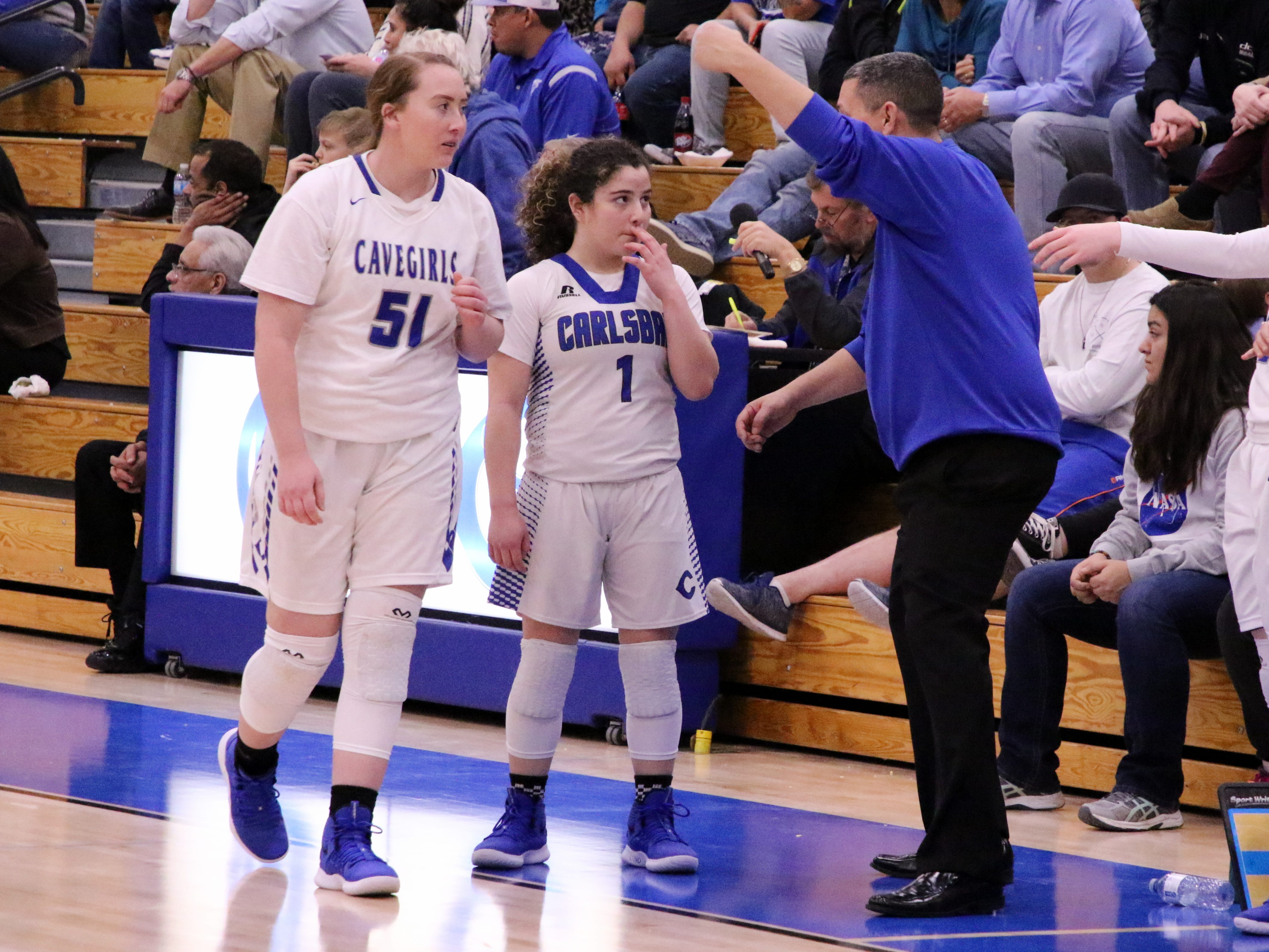 John Zumbrun gives instructions to Jerri Lynn McDonald (1) and Jaelee Bourque (51) during Tuesday's game against Lovington.