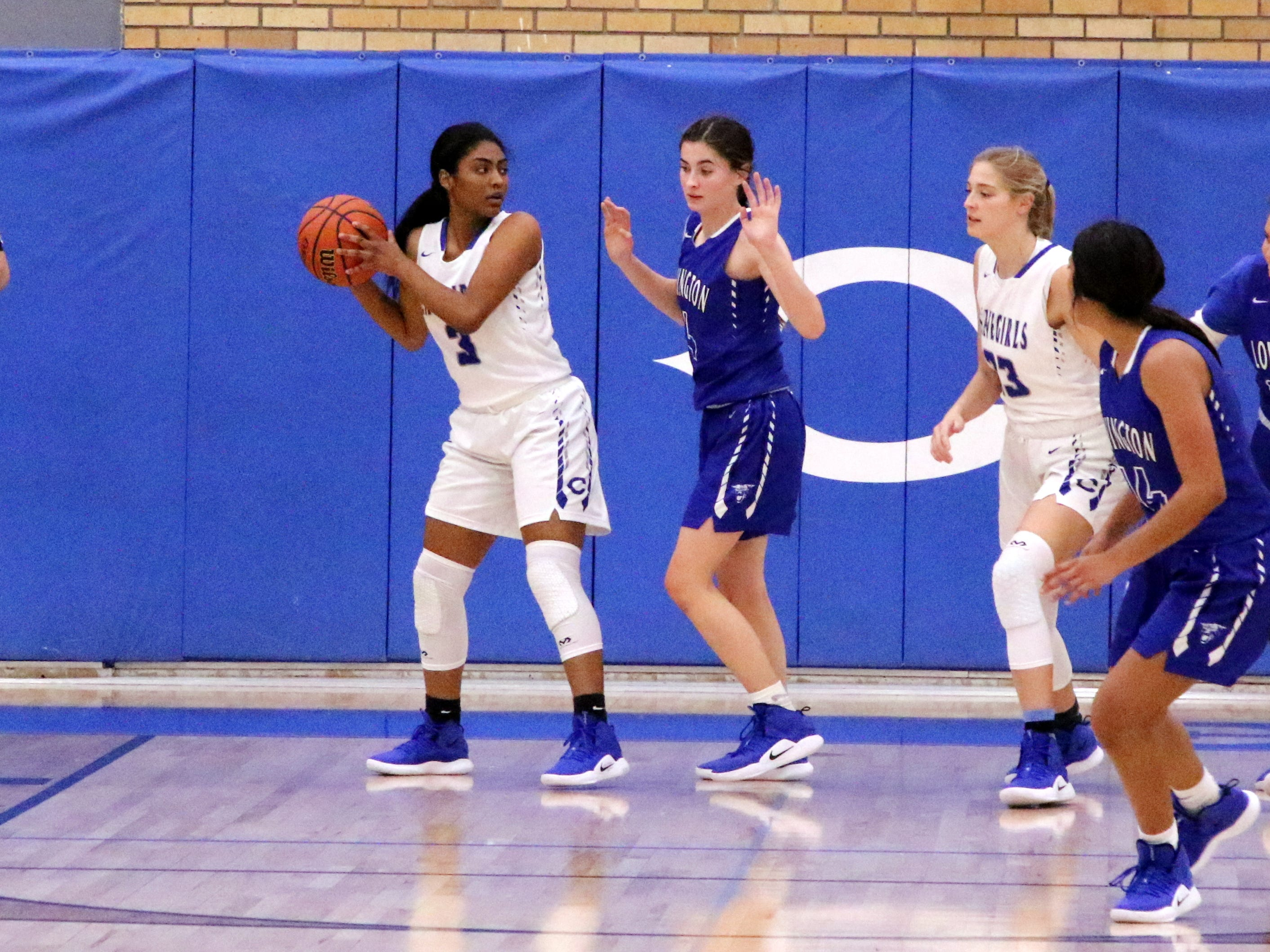 Destiny Young (3) pulls down a rebound in the second half of Tuesday's game against Lovington.