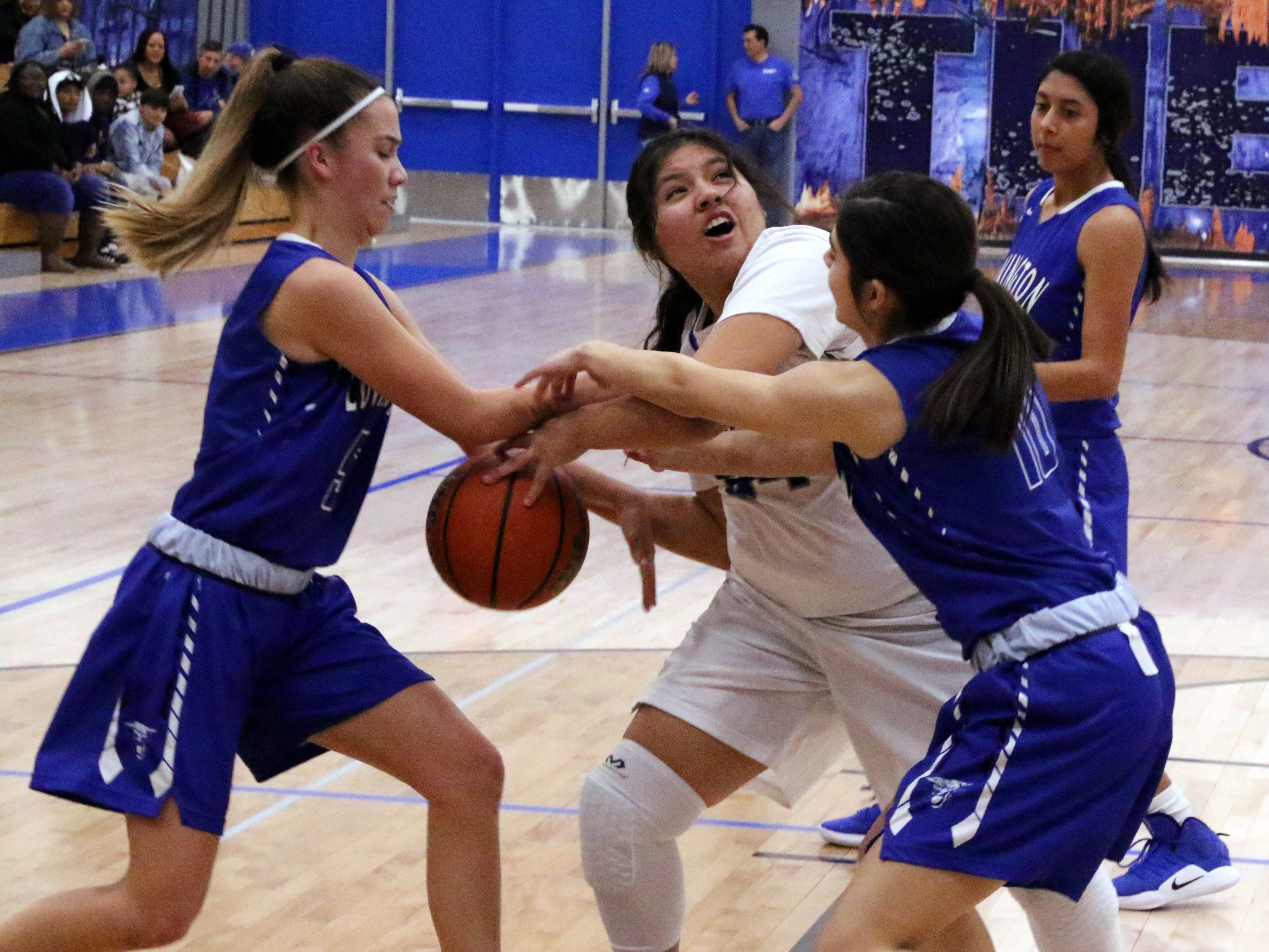 McKenzie Ruiz is fouled going for a shot during Tuesday's game against Lovington.