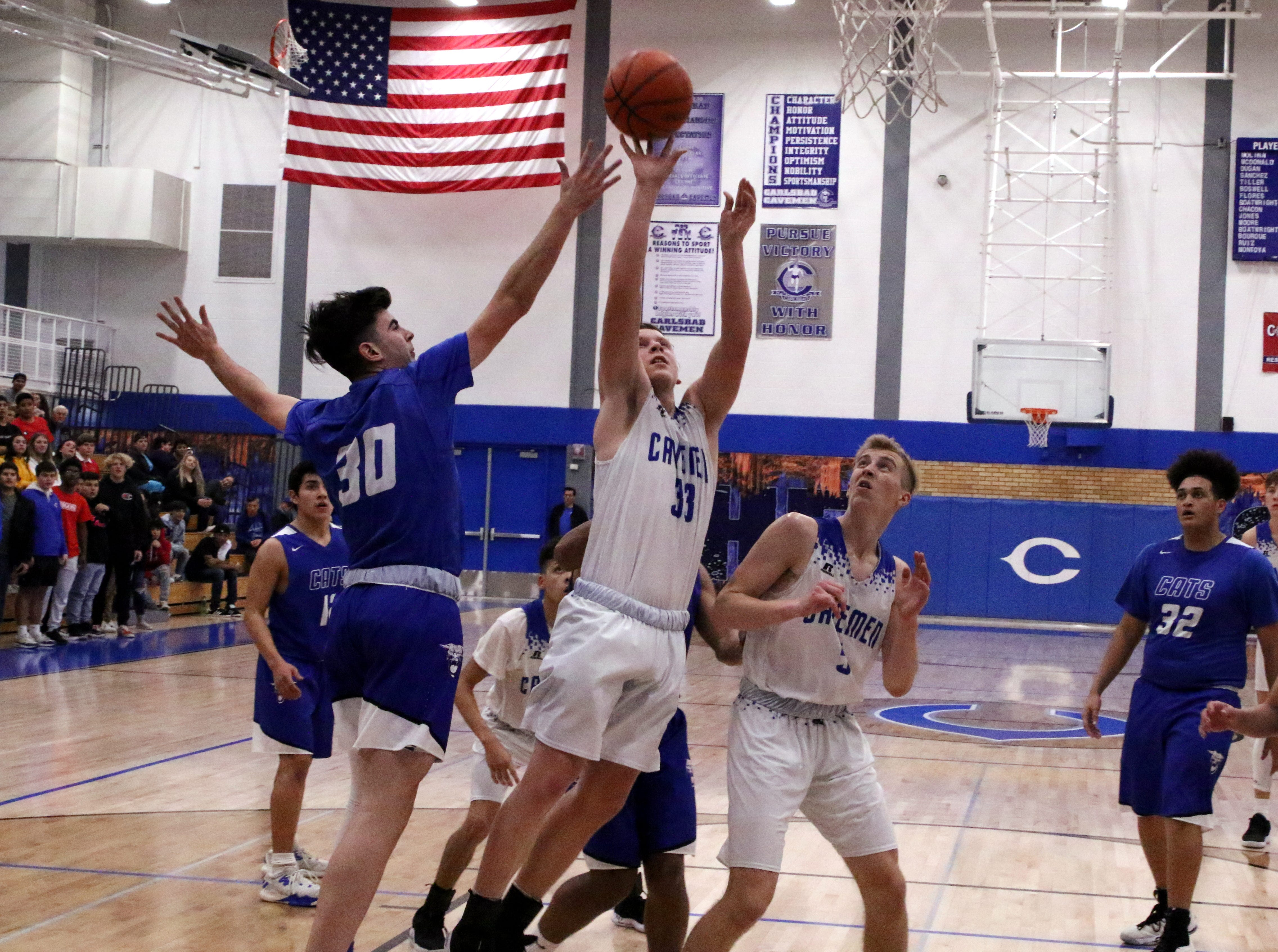 Ayden Parent takes a contested layup during Tuesday's game against Lovington. He finished with five points.